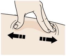 Stretch the skin firmly by moving your thumb and fingers in opposite directions, creating an area about two inches wide.