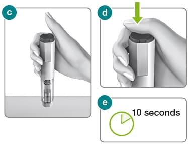 Hold the Rebidose autoinjector in your palm with thumb above the button. Place it upright with the needle end flat against the skin at a 90 degree angle and administer dose.