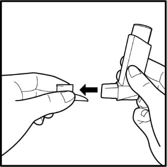 Removing cap from Ventolin HFA inhaler.