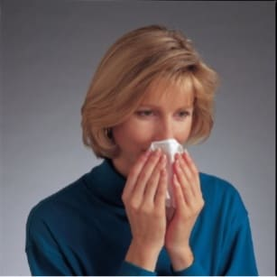 While sitting down, gently blow your nose to clear your nasal passages. image