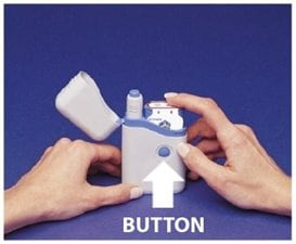 Figure P. image - cartridge pack will click into place when the 2 buttons show through the holes