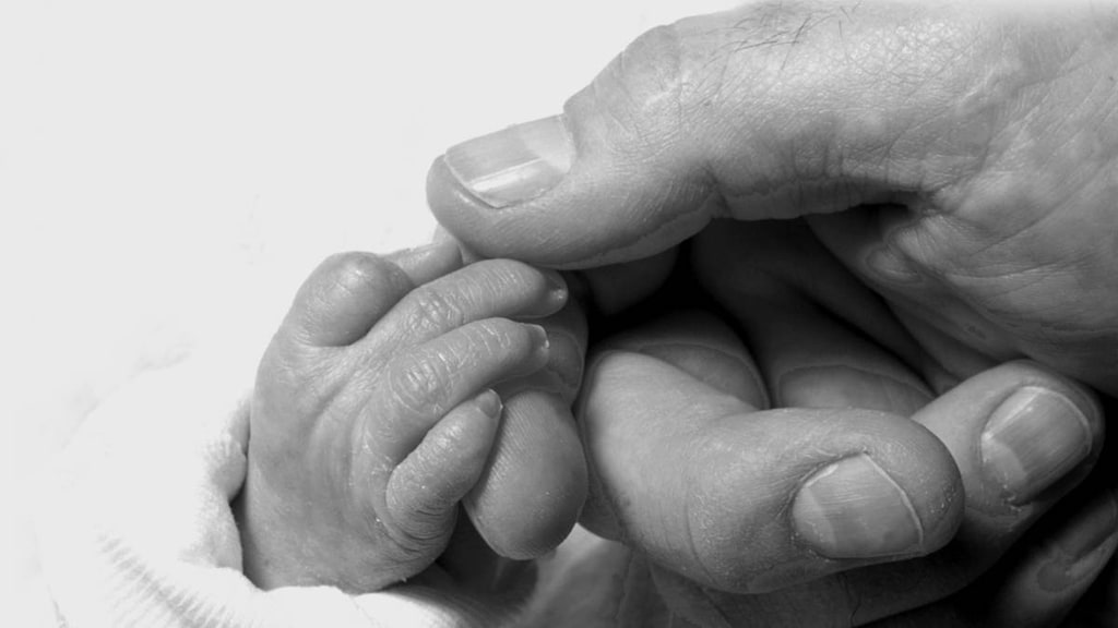 Holding a babies hand