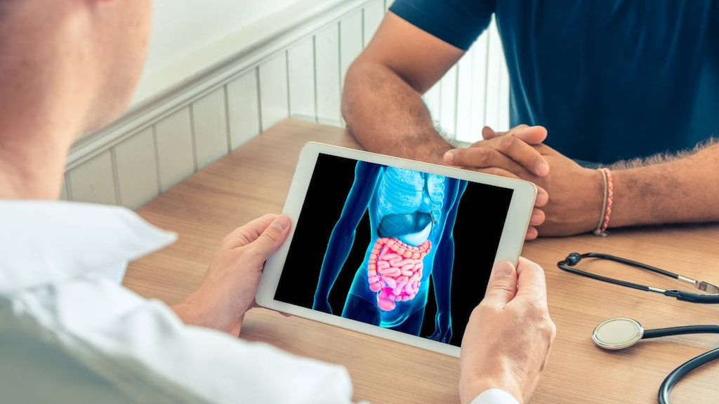 Doctor holding tablet with intestine image
