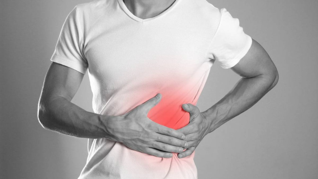 Man showing pain in liver