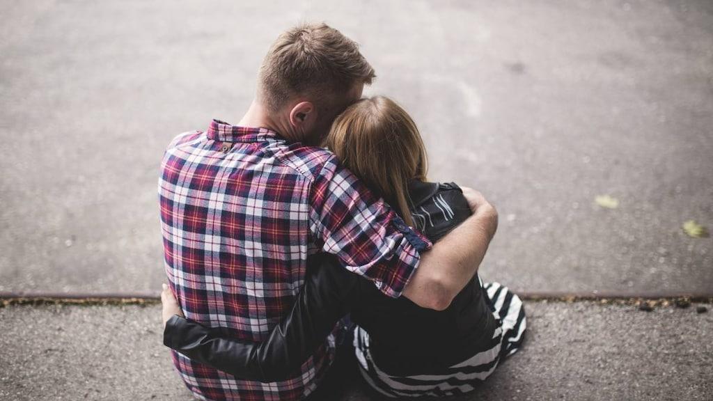 Man comforting unwell woman.