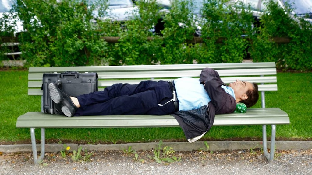 Man sleeping on bench