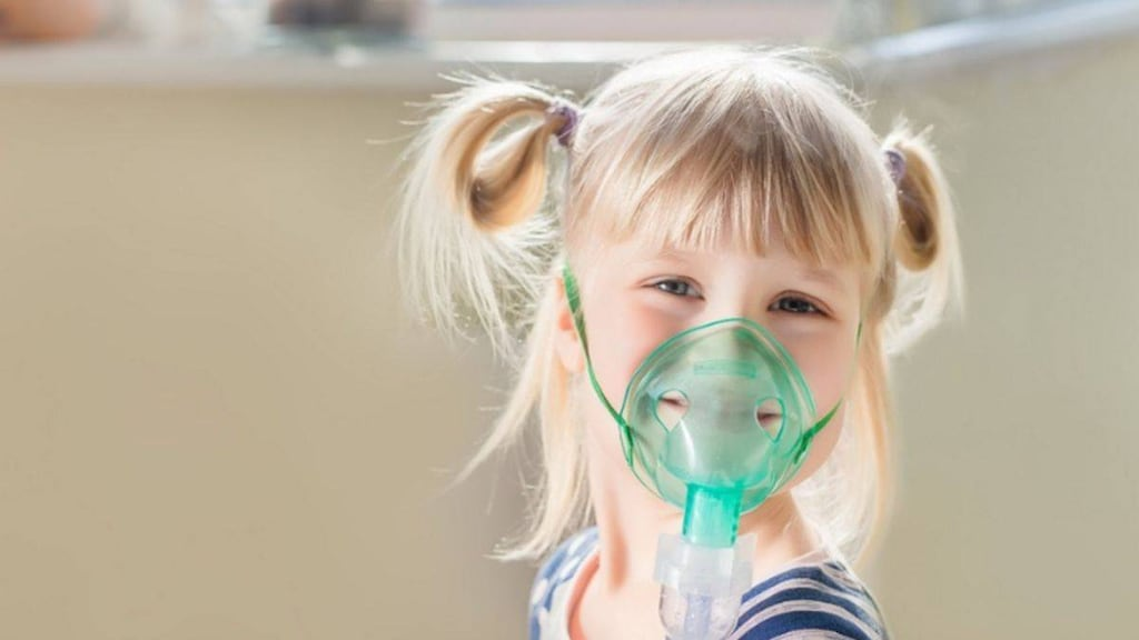 Child using a nebulizer for Asthmma