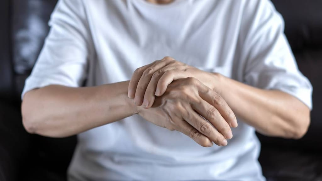 Older person with wrist pain