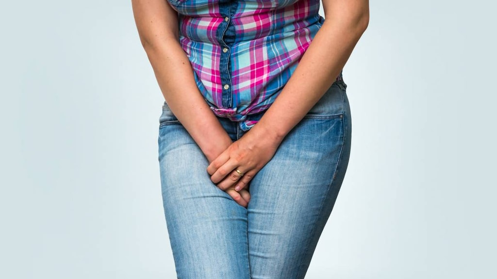Woman covering crotch