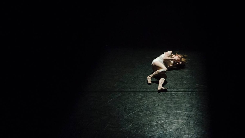 Woman in pain on a dark background