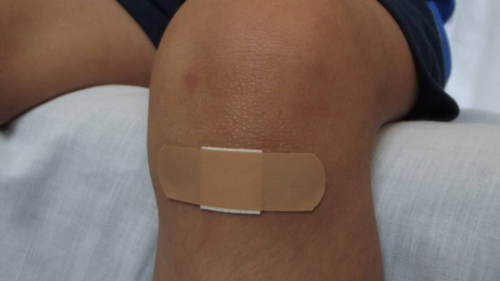 Knee with a plaster on it.
